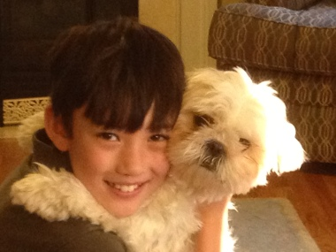Cute, but rotten (the dog, not the boy)!