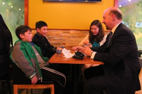 My brother-in-law entertains the boys and his daughter at Breeze Cafe
