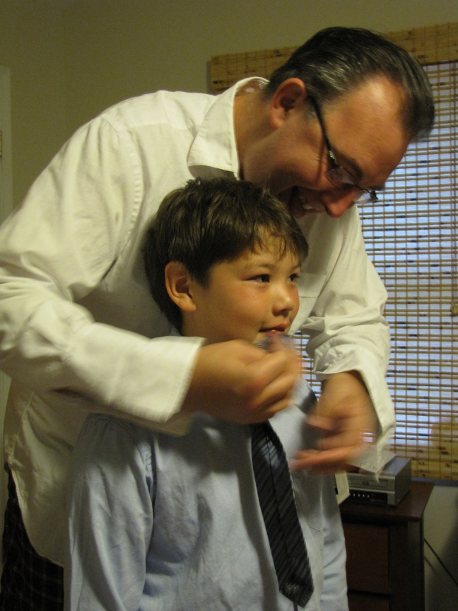 Helping with the tie.