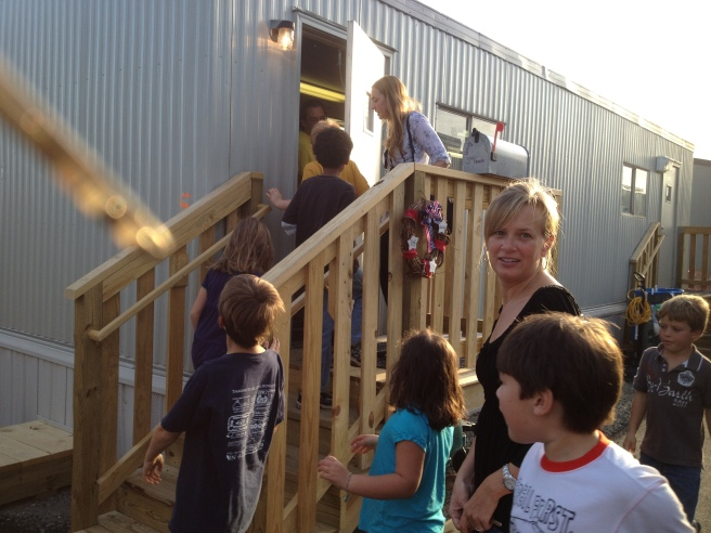 Annika and Helping Hands kids tour temporary trailers at earthquake-damaged school