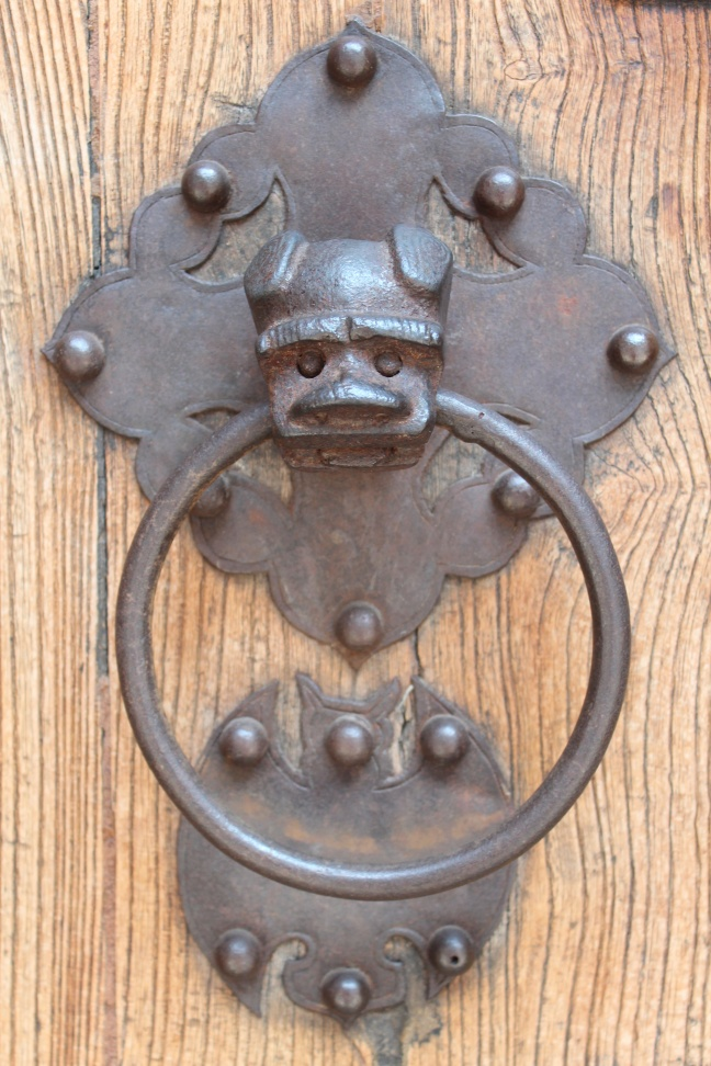 door handle with bat - a symbol of good fortune and longevity