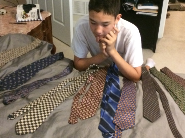 Picking out a tie.