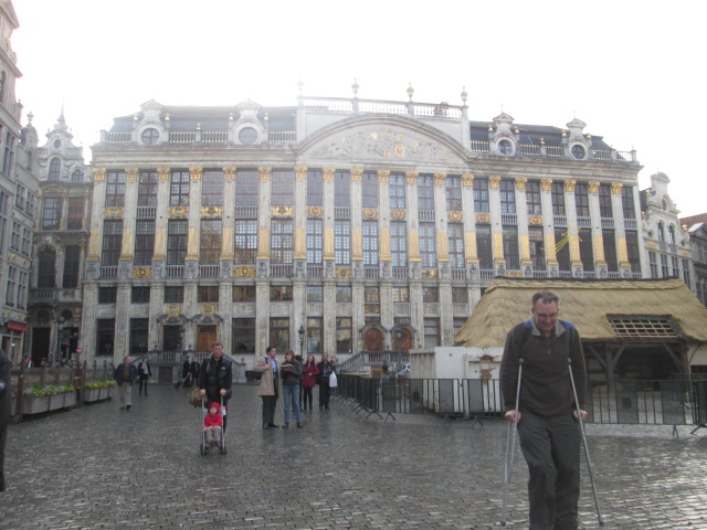 She caught her dad hobbling along in front of Maison des Ducs de Brabant
