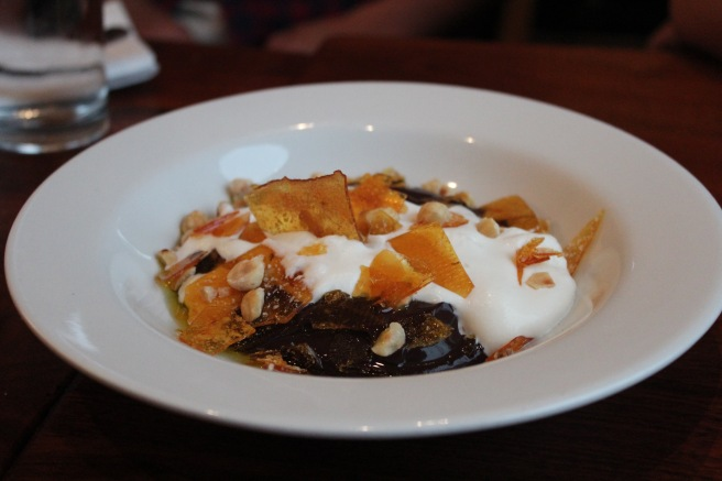 Budino - a magical concoction made of chocolate pudding with hazelnut brittle and olive oil.