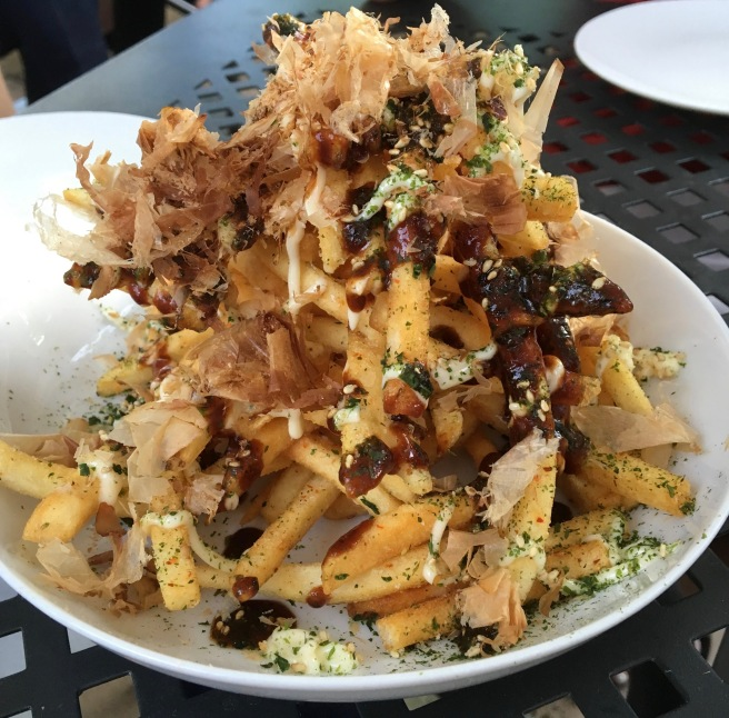Okonomiyaki Fries with yaki sauce, kewpie mayo, furikake, and bonito flakes.